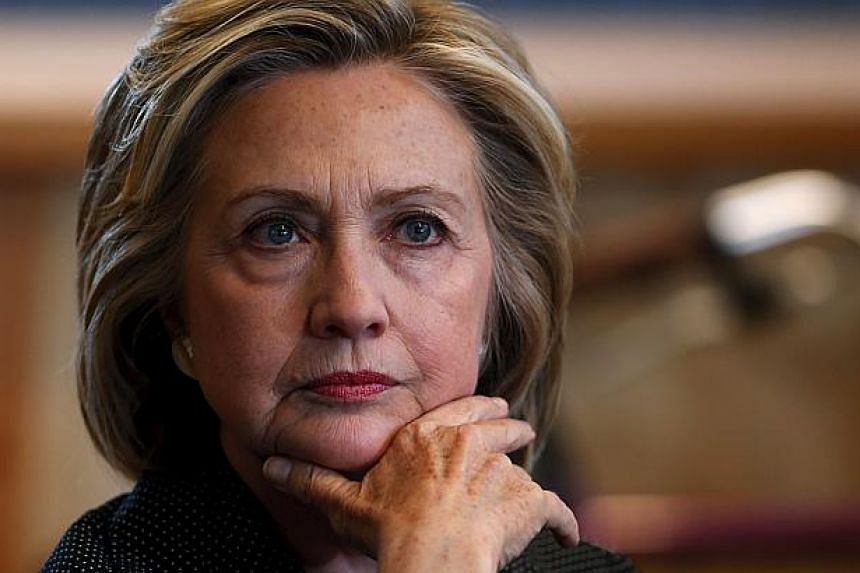 US presidential candidate Hillary Clinton listens to remarks at a roundtable campaign event with small businesses in Cedar Falls, Iowa, United States, May 19, 2015. -- PHOTO: REUTERS