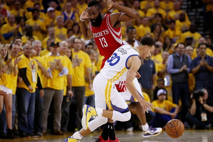 Stephen Curry #30 of the Golden State Warriors drives against James Harden #13 of the Houston Rockets in the first half during Game One of the Western Conference Finals of the 2015 NBA Playoffs at ORACLE Arena on May 19, 2015 in Oakland, California.-