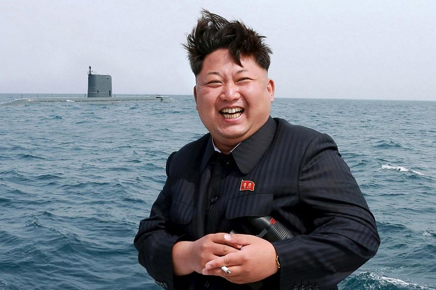 North Korean leader Kim Jong Un watches the test-fire of a strategic submarine underwater ballistic missile (not pictured), in this undated photo released by North Korea's Korean Central News Agency (KCNA) in Pyongyang on May 9, 2015. North Kore