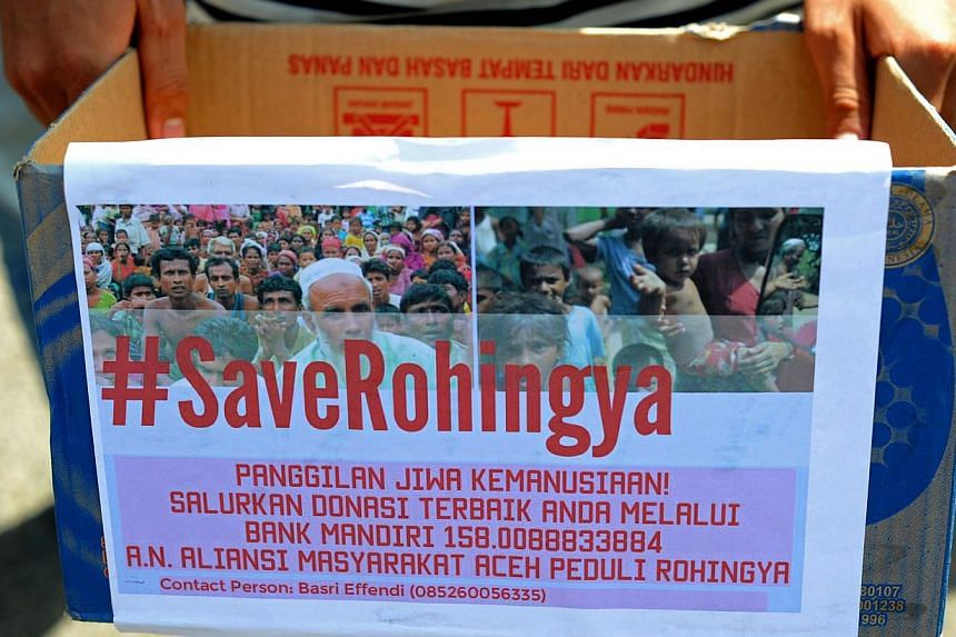 An Acehnese student holds a donation box for charity during a rally in support of Rohingya migrants in Banda Aceh on May 19, 2015. Malaysia's foreign minister was to host his Indonesian and Thai counterparts on Wednesday for urgent talks on South-eas