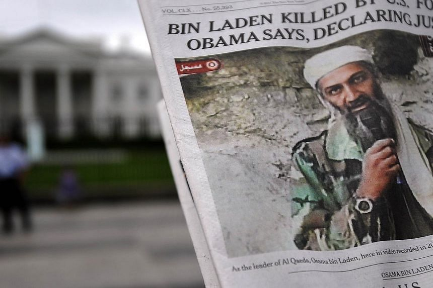 A file photo taken outside the White House in Washington DC on May 2, 2011, shows a photo of Osama Bin Laden in a newspaper. Bin Laden's English language reading list included numerous books by conspiracy theorists and an inordinate number on France,