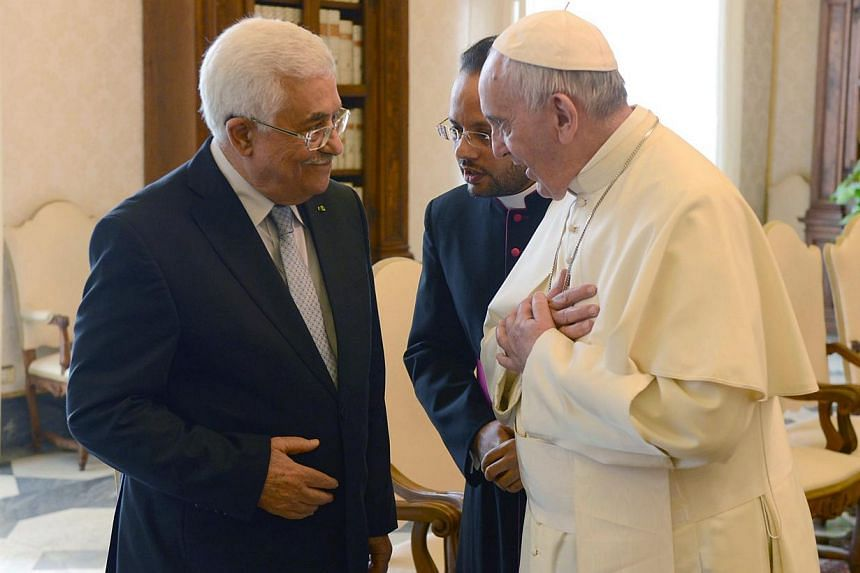 A photograph handed out by the Palestinian Authority shows Pope Francis (right) and Palestinian Authority President Mahmoud Abbas (left) as they speak in the Vatican, May 16, 2015. -- PHOTO: EPA
