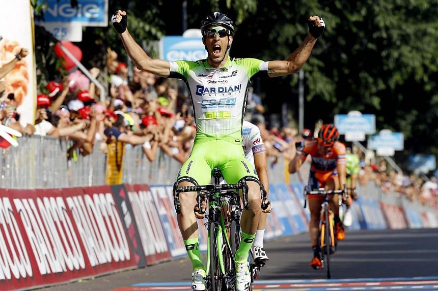 Italian cyclist Nicola Boem crosses the finish line to win the 10th stage of the 98th Giro d'Italia, Tour of Italy, 200 kms from Civitanova Marche to Forli', in Forli on Tuesday. -- PHOTO: AFP