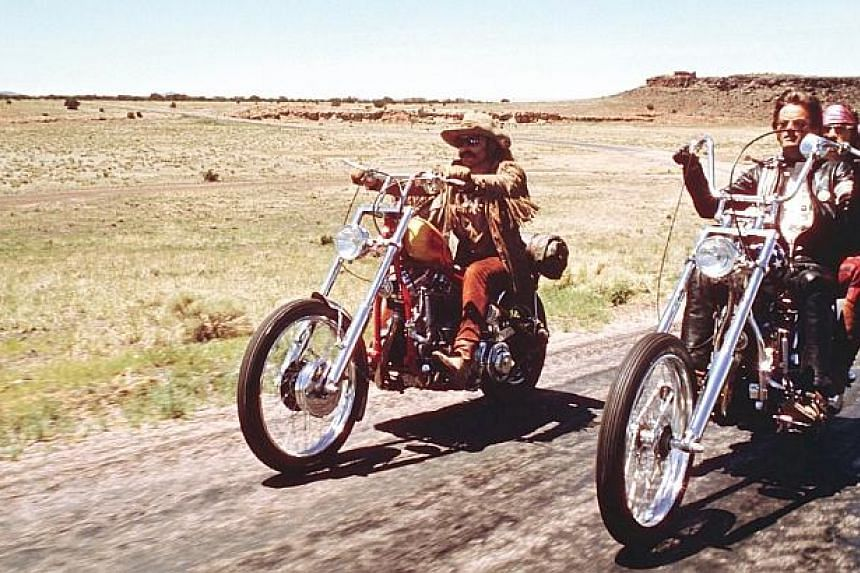 Dennis Hopper (left), Peter Fonda with Jack Nicholson riding pillion (right) in a scene from the classic movie Easy Rider. -- PHOTO: COLUMBIA PICTURES