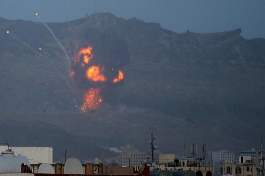 Fire is seen from the Noqum Mountain after it was hit by an air strike in Yemen's capital Sanaa May 19, 2015. -- PHOTO: REUTERS