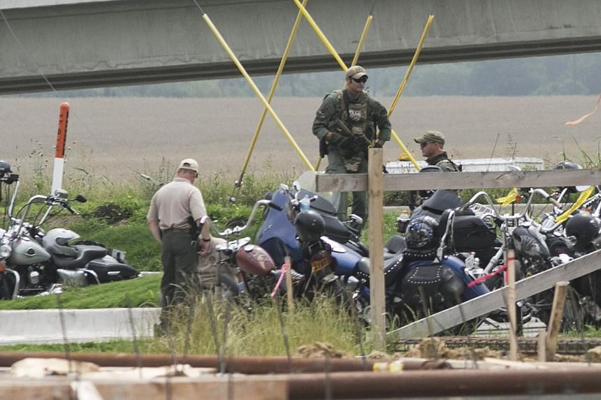 Waco Police investigators at the scene of shooting at the Twin Peaks Restaurant in Waco, Texas, May 18, 2015. A deadly biker brawl in Waco, Texas apparently was set off when a motorcycle gang showed up uninvited at a gathering of rival biker gro