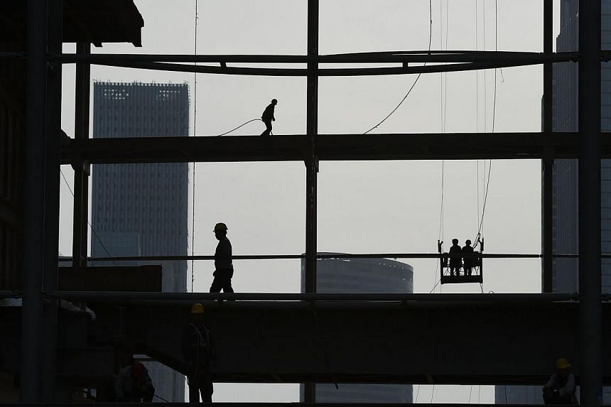 Workers on a construction site in Tianjin, northern China, on May 13, 2015. Chinese Premier Li Keqiang said he was confident that China has the ability to meet its 2015 economic growth target of around 7 per cent, the official news agency Xinhua repo