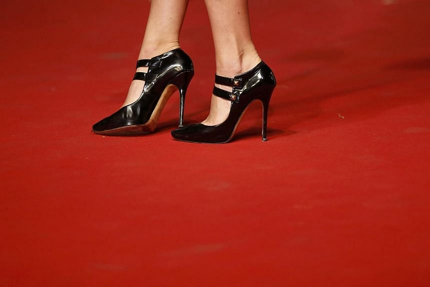 The director of the Cannes Film Festival has apologised after a controversy blew up over women being denied access to the red carpet for not wearing high heels. -- PHOTO: REUTERS