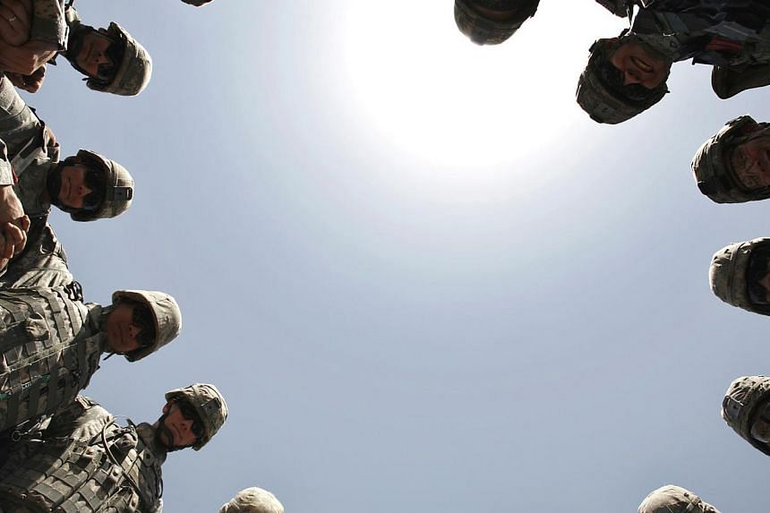 US soldiers forming a circle to pray before leaving for a monitoring mission in Baghdad in 2007. The decision to go to war in Iraq was a clear misjudgment.