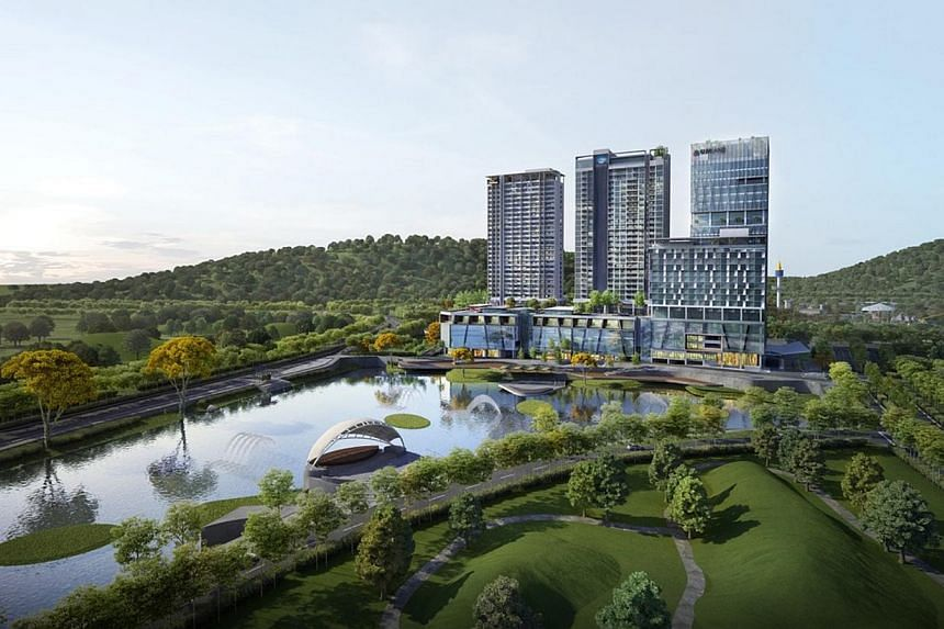 An artist's impression of UMCity Medini Lakeside development in Medini, Nusajaya. The project in the Iskandar Malaysia region comprises three serviced apartment blocks, an office tower and a three-storey retail podium.