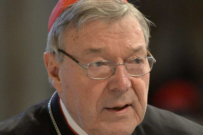 Australia's former top Catholic cleric George Pell (above), now Pope Francis' finance chief, has denied trying to bribe a victim of a paedophile priest to keep quiet as an inquiry heard of horrifying abuse. -- PHOTO: AFP