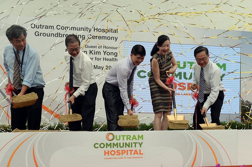 Health Minister Gan Kim Yong (far right) with SingHealth staff and CEO Ivy Ng (second from right) at Outram Community Hospital's groundbreaking ceremony on May 21, 2015. -- ST PHOTO: AZIZ HUSSIN