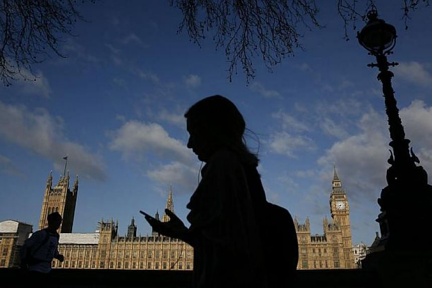 The Houses of Parliament are seen during sunrise in London on March 30, 2015. British police said Wednesday they have received historical child sex abuse claims against 261 public figures, including 76 local- to national-levelpoliticians, as th