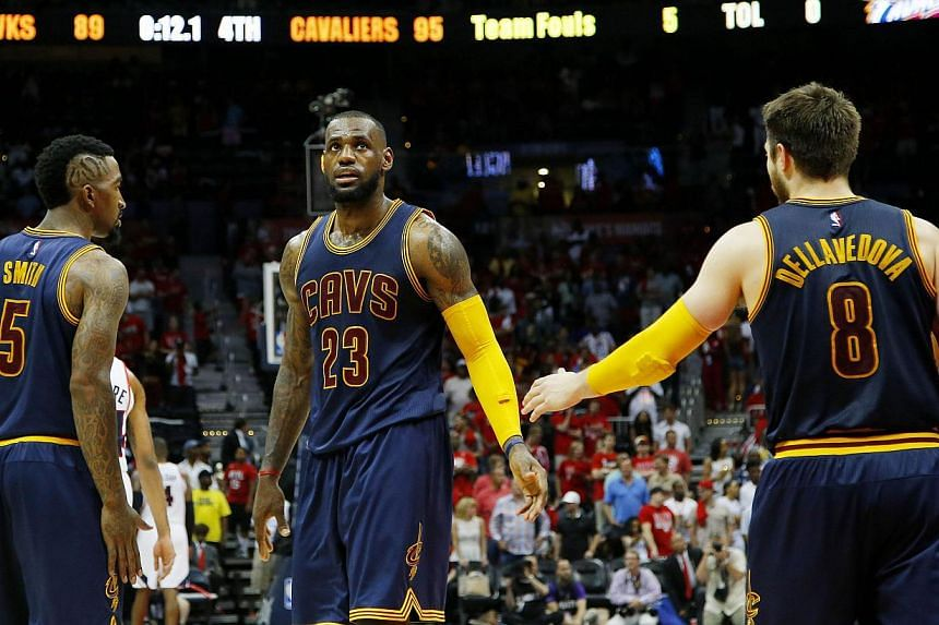 LeBron James (centre), J.R. Smith (left) and Matthew Dellavedova (right) of the Cleveland Cavaliers react after Iman Shumpert drew a foul in the second half against the Atlanta Hawks during Game One of the Eastern Conference Finals of the 2015 NBA Pl