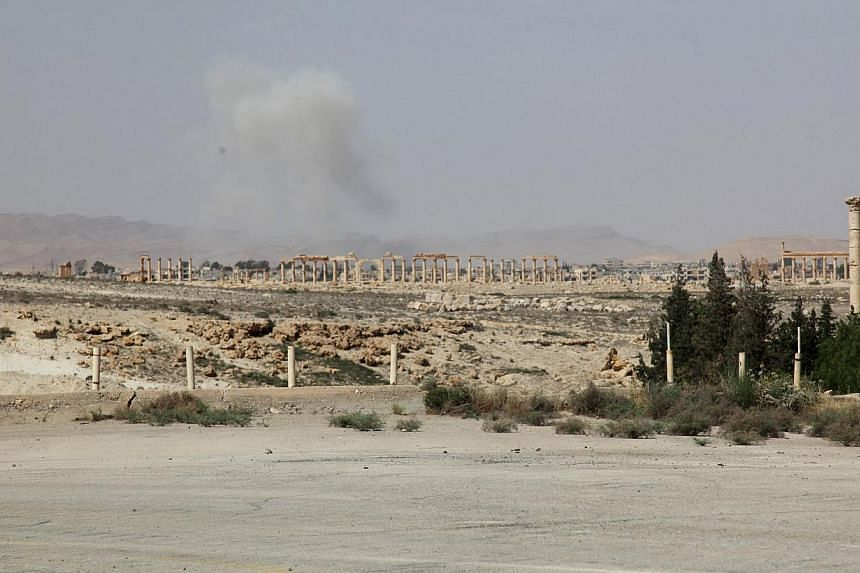 Smoke from what activists said was the result of shelling from Islamic State fighters on Palmyra city, Syria, on May 19, 2015. -- PHOTO: REUTERS