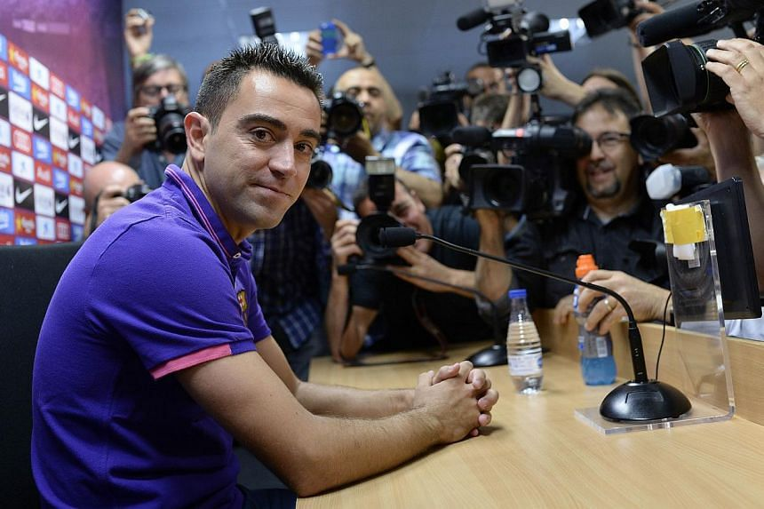 Barcelona legend Xavi Hernandez confirmed on Thursday that he will end his 17-year playing career with the Catalans at the end of the season to join Qatari side Al Sadd. -- PHOTO: AFP