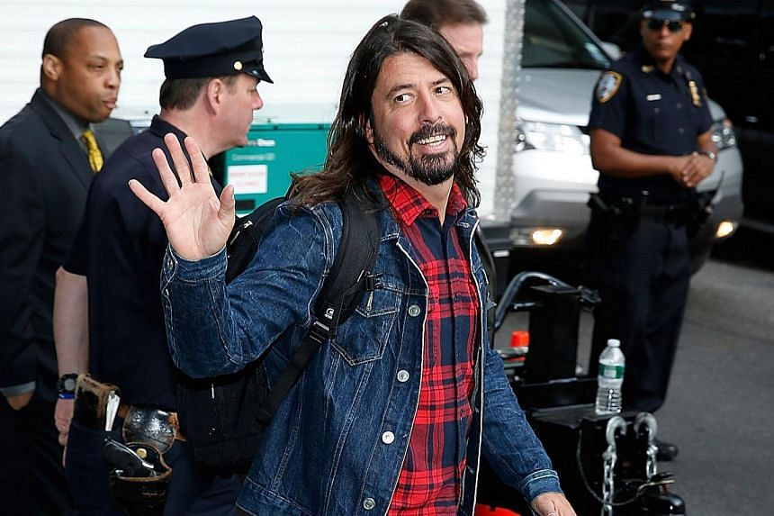 Dave Grohl of the Foo fighters attending the Late Show With David Letterman on May 20, 2015, at the Ed Sullivan Theatre on May 20, 2015, in New York City. -- PHOTO: AFP
