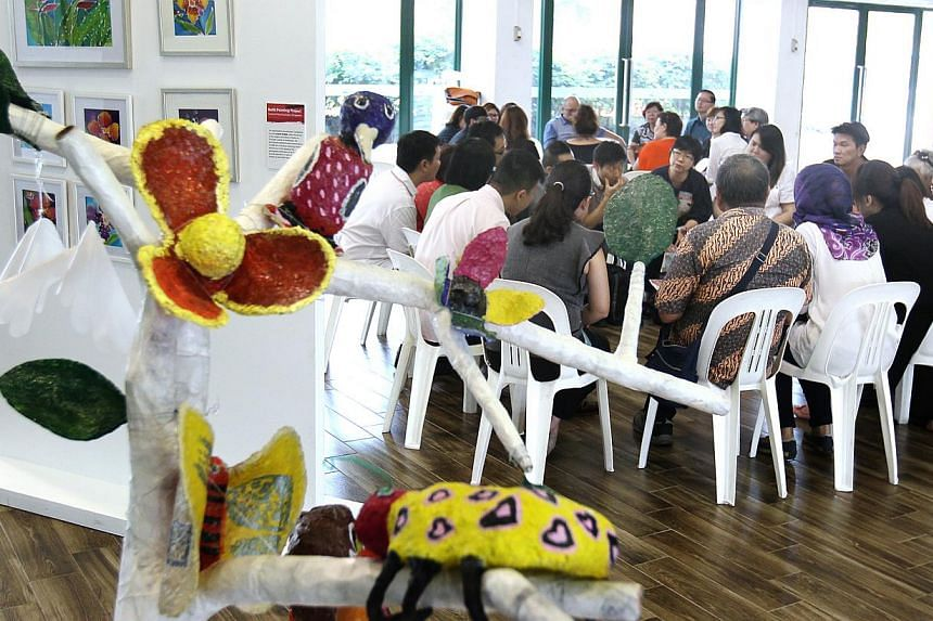 Some art pieces from programmes that tapped the WeCare Arts Fund on display at the tea session, jointly organised by the Community Development Councils and National Arts Council, on Thursday, May 21, 2015. -- PHOTO: LIANHE ZAOBAO