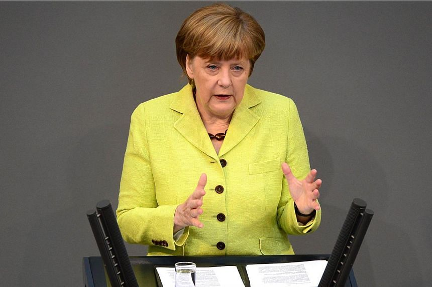 German Chancellor Angela Merkel addresses the lower house of Parliament Bundestag in Berlin,Germany on May 21, 2015 -- PHOTO: AFP