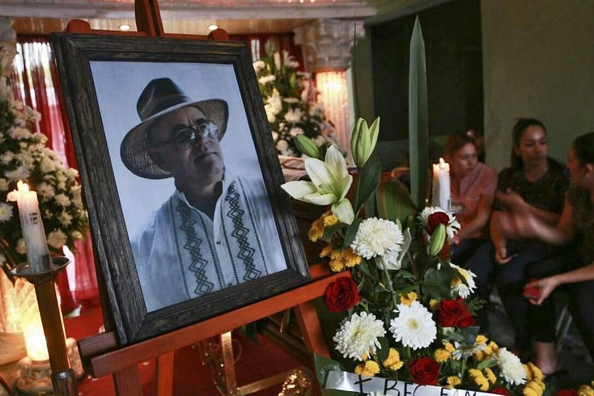 Relatives keeping vigil over the candidate for Yurecuaro mayor Enrique Hernandez (in the portrait) during his funeral chapel at his home in Yurecuaro, in the state of Michoacan, Mexico, on May 15, 2015.A town police chief in Mexico is allegedly
