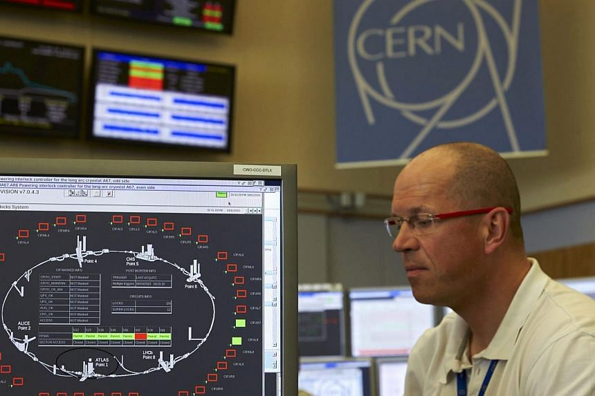 A technician works in the Control Centre of the Large Hadron Collider (LHC) at the European Organisation for Nuclear Research (Cern) in Prevessin near Geneva on March 11, 2015.TheLHC broke the record for energy levels late on Wednesday, May 20,