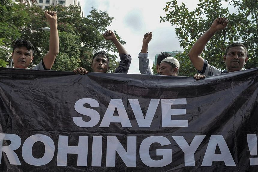Ethnic Rohingya refugees from Myanmar residing in Malaysia protesting outside the Myanmar embassy in Kuala Lumpur on May 21, 2015.The United Nations says desperate relatives are buying back some migrants on boats that are stranded off Banglades
