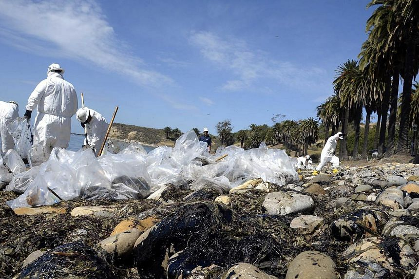 Workers clean up after an underwater oil pipe ruptured spilling an estimated 21 thousands gallons of oil into the Pacific Ocean near Refugio State Beach, 30 miles north of Santa Barbara, California, USA, May 20. Dozens of workers plied the four miles