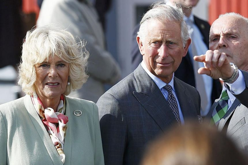 Britain's Prince Charles and his wife Camilla visit the village of Mullaghmore where his great uncle Lord Mountbatten was killed in an IRA bomb attack in 1979, in Ireland, May 20, 2015. -- PHOTO: REUTERS