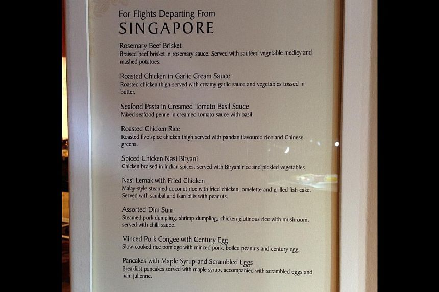 The menu for flights departing from Singapore. -- ST PHOTO: ALPHONSUS CHERN