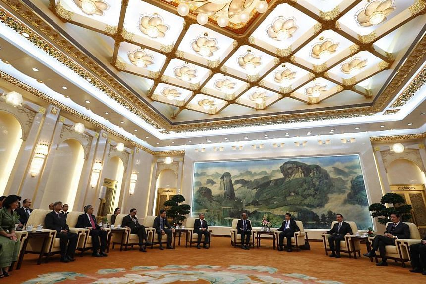China's President Xi Jinping (fourth from right) meeting guests at the Asian Infrastructure Investment Bank launch ceremony at the Great Hall of the People in Beijing in this Oct 24, 2014 photograph. -- PHOTO: REUTERS