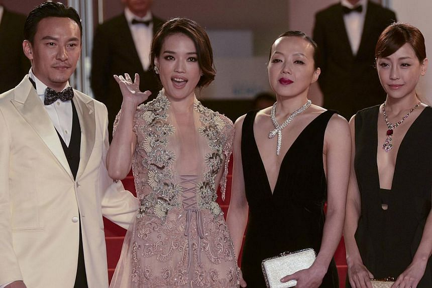(From left) Cast members Chang Chen, Shu Qi, Fang-Yi Sheu and Nikki Hsin-Ying Hsieh on the red carpet as they arrive for the screening of the film The Assassin at the 68th Cannes Film Festival on May 21, 2015. -- PHOTO: REUTERS