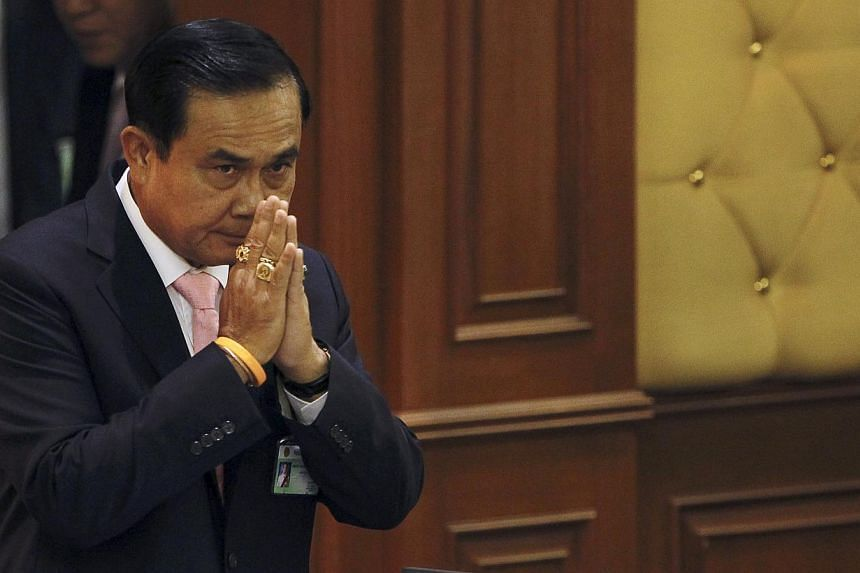 Thailand's Prime Minister Prayuth Chan-ocha gestures in a traditional greeting to National Legislative Assembly members at the parliament in Bangkok, Thailand onMay 21, 2015. -- PHOTO: REUTERS