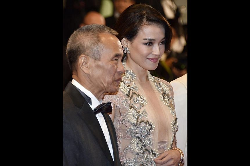 Taiwanese actress Shu Qi (right) and director Hou Hsiao-Hsien at the screening of Nie Yinniang (The Assassin) during the 68th Cannes Film Festival on May 21, 2015. -- PHOTO: EPA