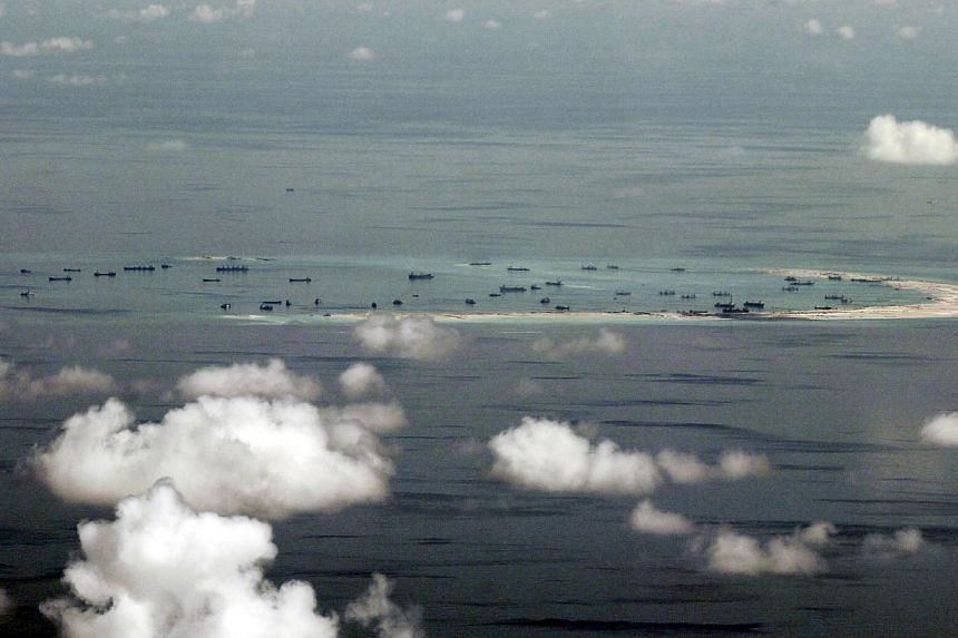 US officials have said they are weighing sending warships and surveillance aircraft within 12 nautical miles of the man-made islands in the South China Sea to test Beijing's controversial territorial claims. -- PHOTO: REUTERS