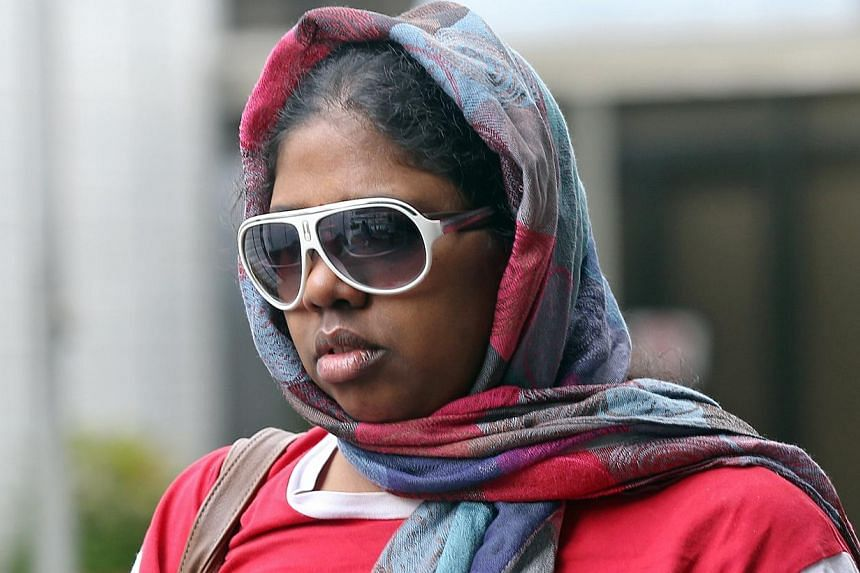 Suganthi Jayaraman, 33,who is charged with maid abuse, is photographed leaving the State Courts on May 22, 2015. She had used household items to hit and burn her domestic worker. -- ST PHOTO: SEAH KWANG PENG