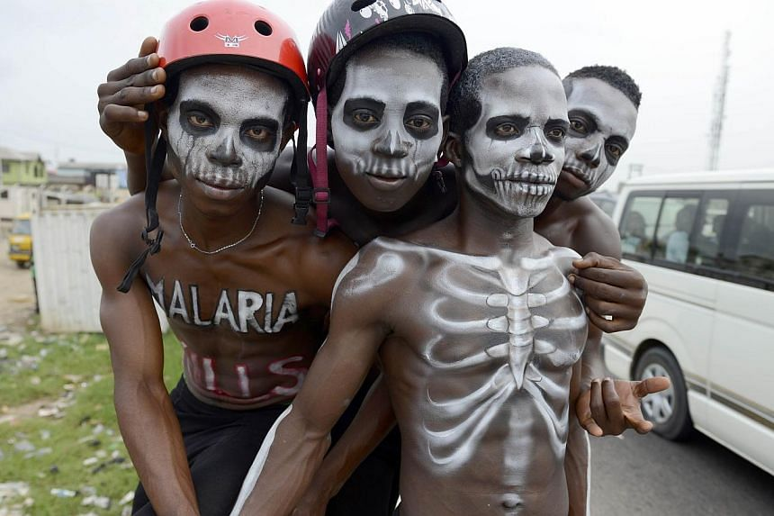 Men painted like skeleton pose on April 24, 2015, in Lagos to warn on the deadly disease prior to the World Malaria Day on April 25.Countries have agreed to rid the world of malaria almost completely over the next 15 years, the World Health Org