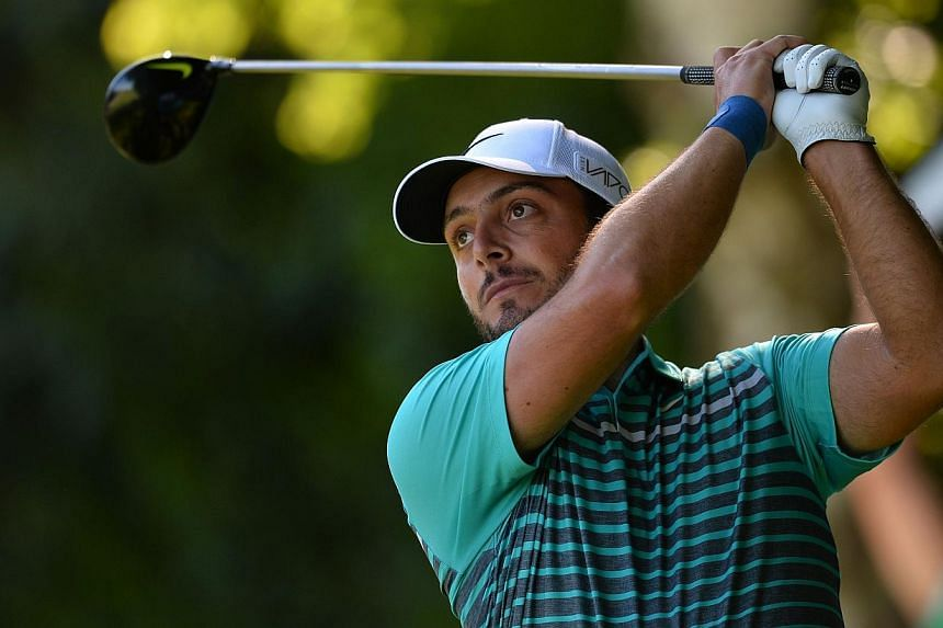 Italian golfer Francesco Molinari watches his drive from the 18th tee during the first round of the PGA Championship at Wentworth Golf Club in Surrey, south west of London, England, on May 21, 2015. -- PHOTO: AFP