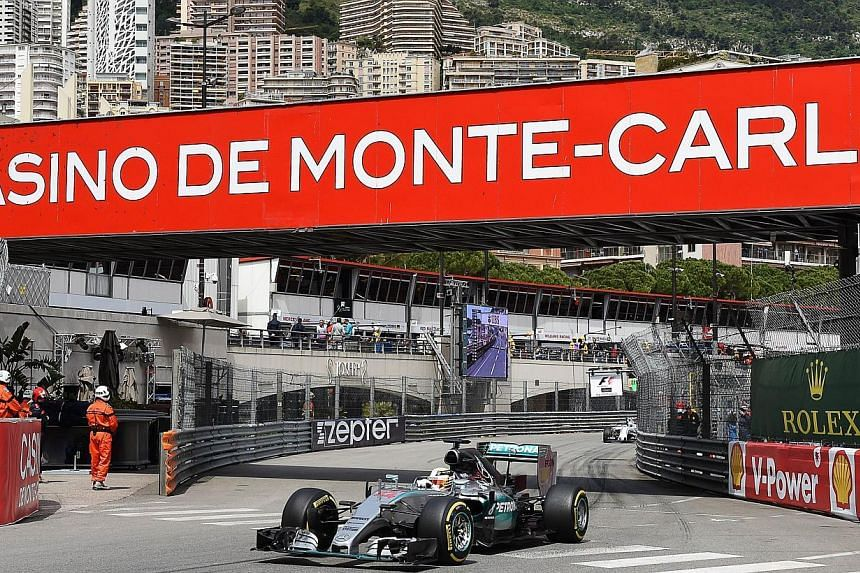 British driver Lewis Hamilton drives during the first practice session at the Monaco street circuit in Monte-Carlo on May 21, 2015, ahead of the Monaco Formula One Grand Prix. -- PHOTO: AFP