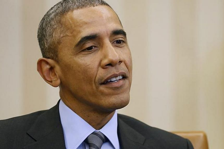 US President Barack Obama (above) has described the loss of key Iraqi territory to Islamic State as a tactical setback, while insisting the war against the extremist group is not being lost. -- PHOTO: REUTERS