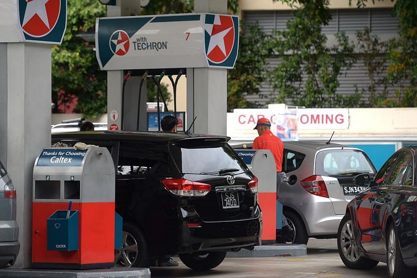 Pump prices have increased twice this month, with motorists now having to fork out up to six cents more a litre for their petrol. -- ST PHOTO:JAMIE KOH
