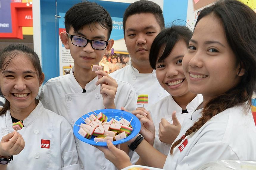(From Left) ITE West students Lim Yi Cin, Poh Zen Feng, Nelson Yeo, Hidayu Salim and Nazirah Arianie, all aged 18. They organised a baking class at Chua Chu Kang Community Club and taught about a hundred residents how to make traditional bites such a