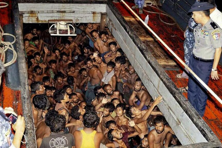 A photo provided by the Myanmar Information Ministry shows Myanmar police officers on a fishing boat filled with migrants in Rakhine on May 22, 2015. Indonesia has told Australia that most of the migrants stranded at sea in South-east Asia are illega