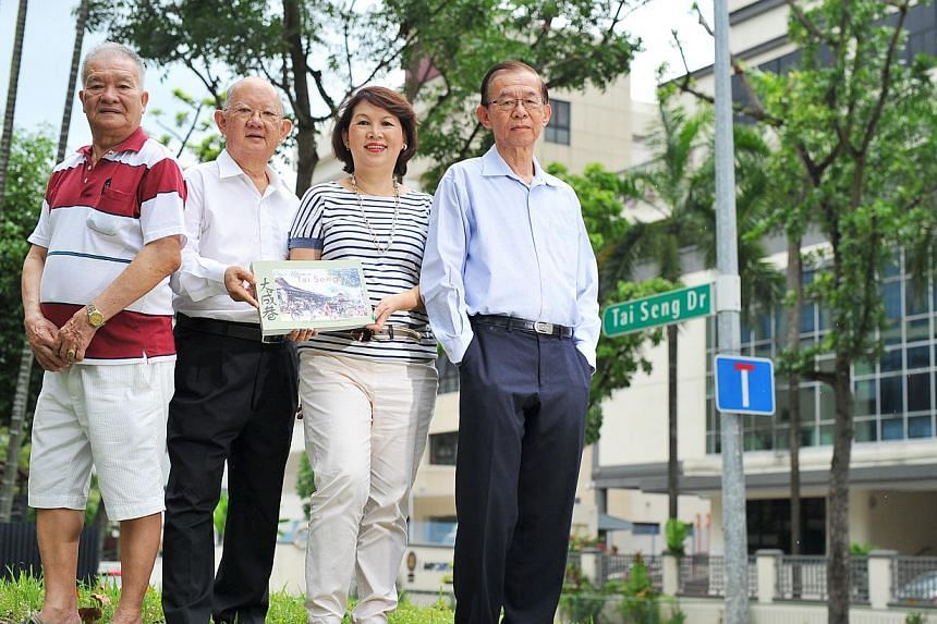 Among the contributors to the book Once Upon A Tai Seng Village are (from left) Mr Ang Mia Chaw, 73, Mr Alec Ang, 70, Ms Ann Phua, 64 - who is also the book's co-author - and Dr Stephen Chee, 78. -- PHOTO: LIM YAOHUI FOR THE STRAITS TIMES