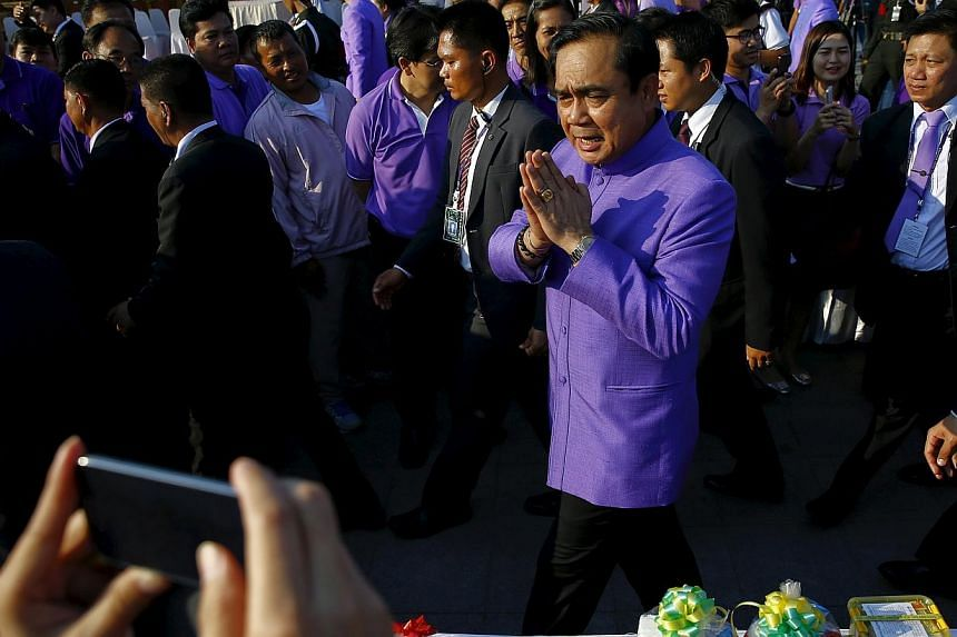 Thai Prime Minister Prayut Chan-o-cha greeting the people at the birthday of Princess Maha Chakri Sirindhorn in Bangkok last month. Gen Prayut has risked alienating the large number of Thaksin supporters under martial law, a group which must be recko