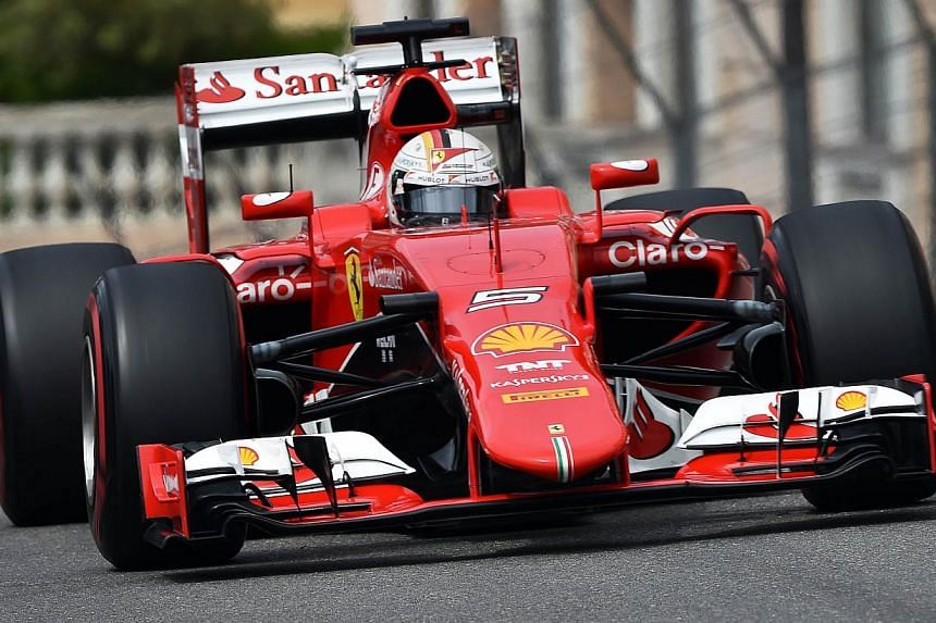 Scuderia Ferrari's German driver Sebastian Vettel drives during the third practice session at the Monaco street circuit in Monte-Carlo on May 23, 2015. -- PHOTO: AFP