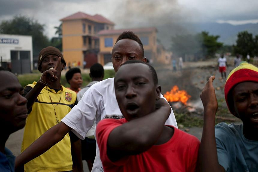 Protesters shout during a protest against Burundi's President Pierre Nkurunziza and his bid for a third term in Bujumbura, Burundi, May 22, 2015. -- PHOTO: REUTERS