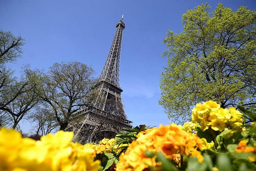 A file picture taken on April 8, 2015, shows a view of the Eiffel Tower. Paris' iconic Eiffel Tower was shut to tourists on May 22, 2015, as staff walked off the job to protest a surge in gangs of pickpockets roaming around the monument. -- PHOTO: AF