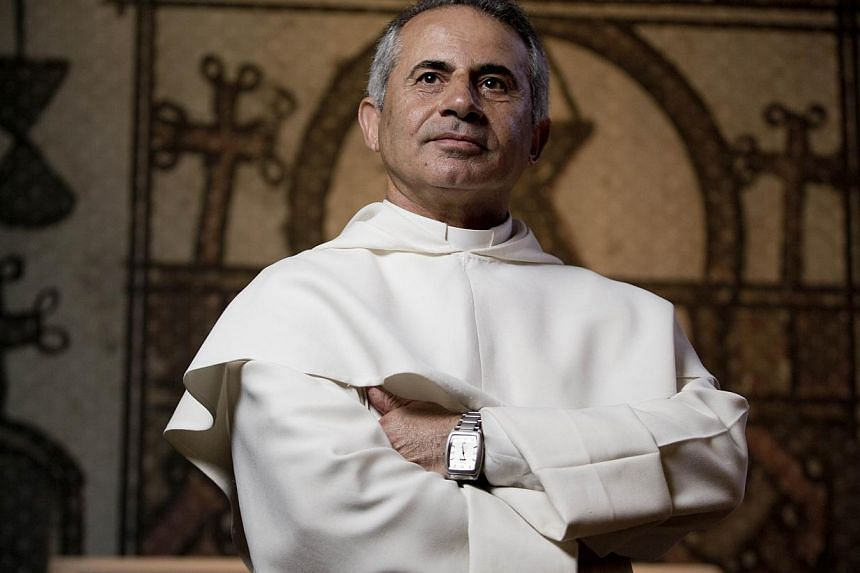Iraqi friar Najeeb Michaeel, of the Roman Catholic Dominican Order, poses on May 22 , 2015 in Paris, at the Hotel de Soubise, where the national archives of France are preserved. -- PHOTO: AFP