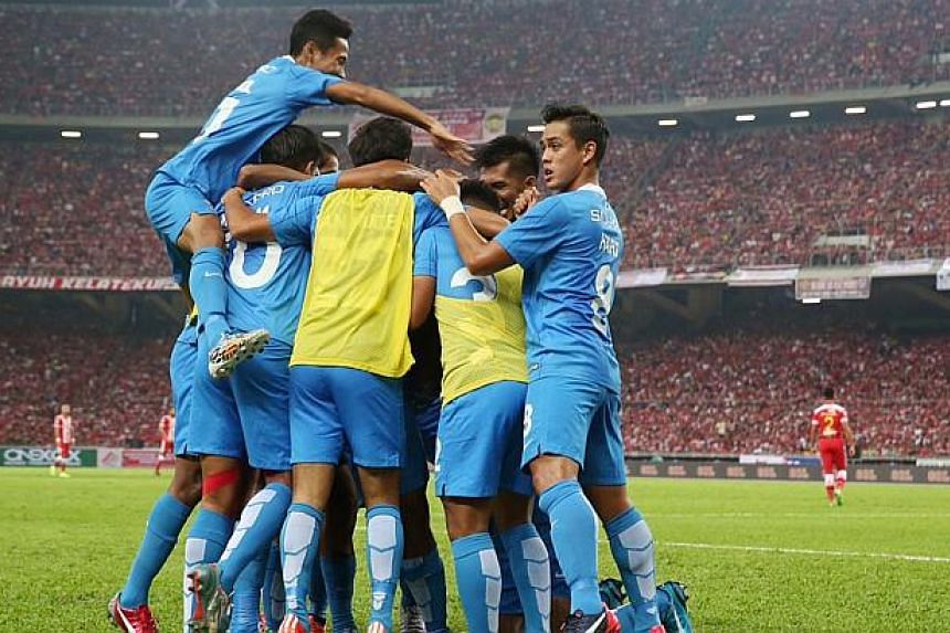 LionsXII celebrating their goal against Kelantan during the FA Cup Final at the Bukit Jalil National stadium on May 23, 2015. -- ST PHOTO: NEO XIAOBIN