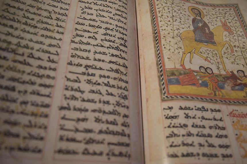 Iraqi friar Najeeb Michaeel and his staff have been working for years to collect and digitise ancient manuscripts, photographing them and storing them on a hard drive.Copies of seven of these documents are currently being displayed at the Natio